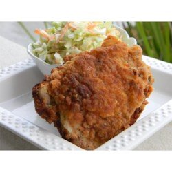 Heather's Fried Chicken Recipe - Chicken thighs and drumsticks marinate all day or overnight in seasoned buttermilk before being floured and deep-fried in this Southern-style treat.