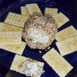 Ultimate Cheese Ball Recipe - This easy cheese ball is good for any occasion. The mixture may be formed into any shape (e.g., a log, a snowman). Serve with buttery, round crackers.