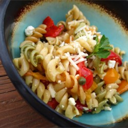 Sweet Pepper Pasta Toss Recipe - Roasted sweet peppers and garlic are tossed with goat cheese, parsley and capers in this delicious, easy pasta dish. Feel free to add any other greens in place of parsley such as cooked spinach or kale.