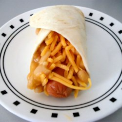 Beanie Weenie Quesadilla Rolls Recipe - A turkey hot dog, bean with bacon soup, and Cheddar cheese rolled in a tortilla make a quick and easy lunch.