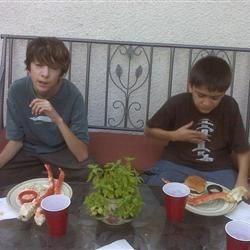 Daren & zachariah enjoying a crabfest on their deck.
