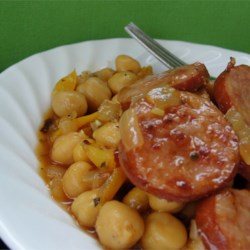 Cuban Smoked Sausage with Chickpeas Recipe - This simple, savory stew combines smoked sausage with chickpeas, sherry, and flavorful seasonings. It's delicious over steamed white rice.