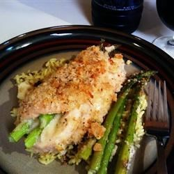 Asparagus and Mozzarella Stuffed Chicken Breasts Recipe - Skinless, boneless chicken breasts are pounded thin, rolled around fresh spears of asparagus with mozzarella cheese, and baked for an easy spring dinner that's ready in less than an hour.