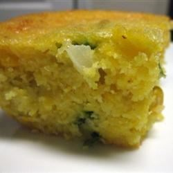 Mexican Style Cornbread Recipe - This buttermilk cornbread is thick with creamed corn, Cheddar cheese, fresh onion and jalapeno pepper.  A melted Cheddar crust tops it off.