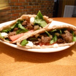 LIZZY217's Lamb Gyros Recipe - Brandy, marjoram, and thyme flavor lamb cubes in this sandwich served with homemade tzatziki sauce.