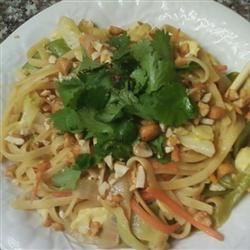 Thai Noodles and Chicken Recipe - The combination of peanut butter, soy sauce, red pepper and brown sugar makes this dish Thai. The grilled chicken, coleslaw mix and chopped peanuts makes it absolutely delicious...and it's ready in just 30 minutes.