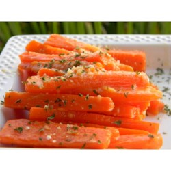 Parmesan Crusted Baby Carrots Recipe - Tender carrots are cooked with butter and Parmesan cheese in this easy, three-ingredient side dish.