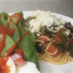 Quick and Easy Greek Spaghetti  Recipe - Spaghetti in sauce gets a Greek-style lift in flavor from spinach, balsamic vinegar, tomatoes, and feta cheese.