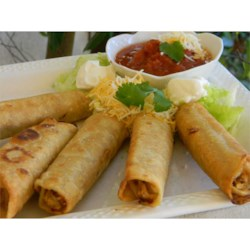 Crispy Flautas Recipe - Corn tortillas are filled with shredded seasoned chicken, cheese, and your favorite salsa, then fried to a golden crisp.