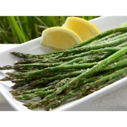 Grilled Lemon Parmesan Asparagus Recipe - Jazz up your asparagus with Parmesan cheese and lemon juice before placing it on the grill.