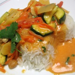 Thai Red Chicken Curry Recipe - This is a quick and easy curry stir-fry made with chicken, zucchini, red bell pepper and carrot. Coconut milk and curry paste make an irresistible sauce. No need to go out to eat, as this dish is ready in about 20 minutes!