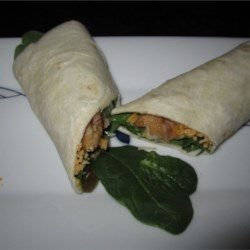 Baked Tofu Spinach Wrap Recipe - These are quick, simple and tasty!  My husband, who previously hated tofu (although this was deli style tofu), loved them and asked for more.