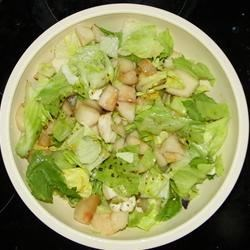 Pear, Feta, and Lettuce Salad Recipe - Crisp pears, balsamic vinaigrette, and feta cheese blend wonderfully in this light salad.
