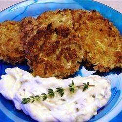 Zucchini Cakes Recipe - Shredded zucchini combined with bread crumbs, egg, mayonnaise, mustard and Old Bay Seasoning, and formed into patties and baked.  The flavor of the Old Bay with the texture of the zucchini makes a great substitution for crab cakes.