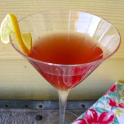 Cosmo-Style Pomegranate Martini Recipe - This drink is similar to a Cosmopolitan, but uses pomegranate juice.