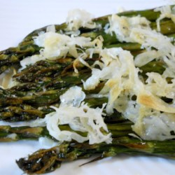 Broiled Asparagus Parmesan Recipe - Asparagus steamed and then broiled in the oven with a light dusting of Parmesan and lemon butter is a quick vegetable side dish for your dinner table.