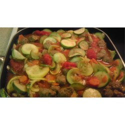 Aunt Rita's Italian Stew Recipe - Mild Italian sausage simmers with summertime vegetables like zucchini and summer squash to make an easy skillet supper with Italian-inspired flavors.