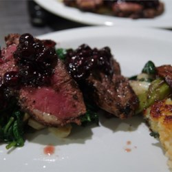 Pan-Seared Duck Breast with Blueberry Sauce Recipe - An elegant and eye pleasing menu of pan-seared duck breast with blueberry sauce served on a bed of bok choy, wild mushrooms, pancetta, and shallots. Roasted potatoes seasoned with rosemary and thyme complete this meal, perfect for any special occasion.