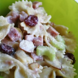 Cranberry and Almond Pasta Salad Recipe - Bow-tie pasta, dried cranberries, sliced almonds, and celery are tossed with a mayonnaise and apple cider-based dressing in this tangy pasta salad recipe.