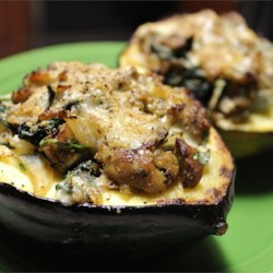 Stuffed Acorn Squash Recipe - Acorn squash halves are filled with butter, brown sugar, stuffing mix, chicken broth and savory spices, and baked.  Sprinkle with Parmesan cheese, if desired.