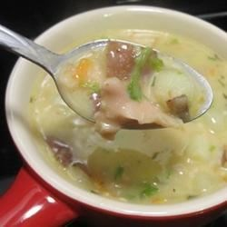 New England Clam Chowder III Recipe - A huge batch of chowder made with chicken broth, cream and clams is seasoned with thyme and thickened with a roux.
