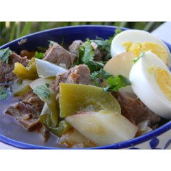 Ajiaco (Beef and Pepper Stew) Recipe - This is my take on the ubiquitous Latino stew, ajiaco. This version uses leftover roast beef, sweet red peppers, and creamy baby potatoes simmered together in a spicy broth.