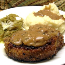Grandma's Pork Chops in Mushroom Gravy Recipe - There are no canned soups in this masterpiece. This is my Grandma's recipe that she gave me when I got married. Pork chops are baked then served with a rich mushroom sauce. It takes a little bit of work, but is great for a special dinner - my husband loves it!