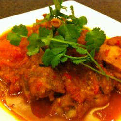 Spicy Tomato Chicken (Ayam Masak Merah) Recipe - Chicken is simmered in a fragrant sauce of chile peppers, turmeric, cinnamon, star anise, cloves, and cardamom.