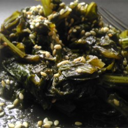 Asian-Inspired Mustard Greens Recipe - The tangy, bold taste of quickly cooked mustard greens pairs perfectly with nutty sesame oil and Japanese rice wine for a simple but savory side dish with an Asian inspiration.