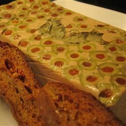 Tuna Mousse Terrine with Olives Recipe - Tasty and beautiful, this mousse-like textured terrine is impressively studded with pimento-stuffed olives. It's great for entertaining and looks far more difficult than it really is. Serve it on greens along with crackers or slices of Melba toast.