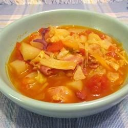 Irish Bacon And Cabbage Soup Recipe and Video - This is a wonderfully simple chunky soup. I use good quality Irish back bacon but if you can't get this, it tastes equally good made with pancetta. The dark green colour of the cabbage alongside the tomatoes gives the soup a beautiful colour.