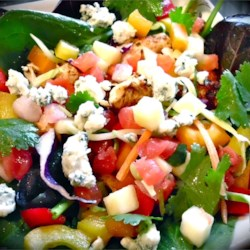 Chicken Mango Salsa Salad with Chipotle Lime Vinaigrette Recipe - A delicious, colorful, sweet and spicy salad with diced chicken, a mango pico de gallo salsa, blue cheese, and cranberries is served with a wonderful chipotle lime vinaigrette. It's almost too pretty to eat...Almost.