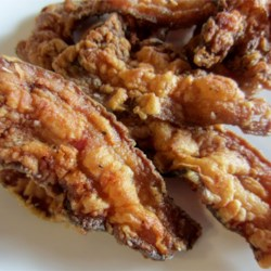 Country Fried Floured Bacon Recipe - OOh's and Mmmm's before, during, and after eating this spiced bacon will become common place for your household. Every time I just suggest cooking this recipe, those sounds begin. My grandmother, my mother, and me cook this bacon for our family and friends, and it is always a favorite once it has been tried by one and all.