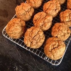 Pumpkin Spice Muffins Recipe - Less sweet than most, these nutritious whole wheat muffins are generously spiced with cinnamon, nutmeg and almond extract.  Applesauce replaces most of the oil for healthy, tasty snacking.