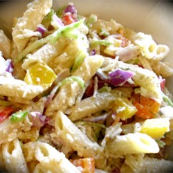 Penne Pasta Salad Recipe - Julienne oranges and yellow peppers and red onion make this easy pasta salad beautiful. And the creamy dressing, spiked with mustard, parmesan and dill, makes it as delicious as it is comely. Serves twelve.