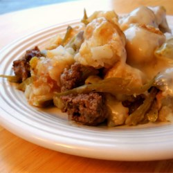 Tater Tot Hot Dish II Recipe - Layers of seasoned ground beef, tater tots, creamy soups and French-fried onion rings build a great autumn casserole.