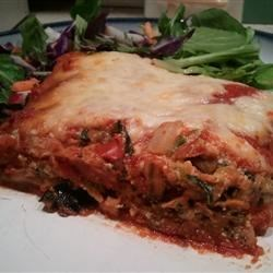 3-Cheese Eggplant Lasagna Recipe - Substituting eggplant slices for lasagna noodles makes this three-cheese vegetable lasagna light and flavorful.