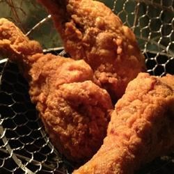 Firecracker Fried Chicken Drumsticks Recipe - Drumsticks are marinated in hot sauce overnight, then coated in seasoned cornmeal and fried.