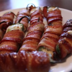 Grilled Bacon Jalapeno Wraps Recipe and Video - Cream cheese-filled jalapeno poppers are wrapped with bacon and grilled for this easy party snack.