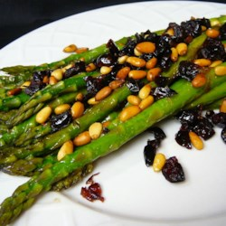 Asparagus with Cranberries and Pine Nuts Recipe - This is a quick, easy way to saute asparagus. The dish has a light flavor and makes a great accompaniment to Italian meals. I make this year-round, but we especially enjoy it on Thanksgiving.