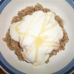 Quinoa with Peaches and Creamy Yogurt Recipe - Don't overlook quick-cooking quinoa as a hot breakfast cereal, especially when it's topped with peaches and yogurt. Cinnamon, nutmeg, and a bit of honey and lime juice add their delicious flavors.