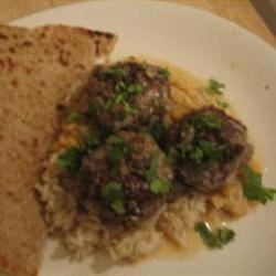 Pakistani Meatballs with Gravy (Koftay) Recipe - Meatballs made with an exciting blend of spices are cooked in a smooth, flavorful yogurt gravy. This is a classic Pakistani recipe that's great garnished with coriander and served with naan.