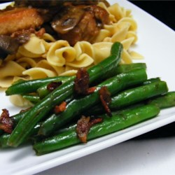 Savory Green Beans Recipe - Fresh green beans with sweet caramelized shallots and savory Italian pancetta take vegetables to a whole new level.