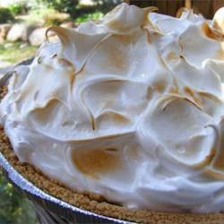 Fresh Strawberry Pie II Recipe - Fresh strawberries are piled into a graham cracker crust and topped with a fluffy cooked meringue. You'll need a stand mixer to make this recipe.