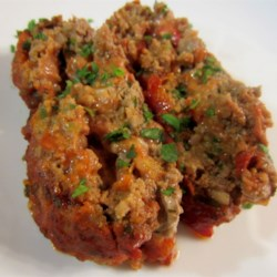 Meatloaf Roll Recipe - Make a meatloaf with an Italian attitude. A seasoned beef mixture is rolled around mozzarella cheese and baked with a homemade Italian-style tomato sauce.