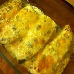 Chele's Halibut Recipe - This quick and easy halibut is topped with a green onion and sour cream layer. Broiled Parmesan cheese is the final touch.