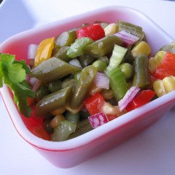 Green Bean Salad Recipe - Green beans, peas, corn, pimento, and other veggies marinate overnight in a tangy vinaigrette dressing.