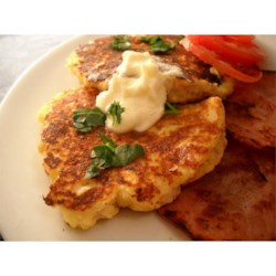 Mountain Mama's Potato Pancakes Recipe - Savory potato pancakes with onion and cheese are easy to make, because you start with instant mashed potatoes and prepared pancake mix. Make up a big batch of dry mix ahead of time, and these take only a few minutes to get on the table.