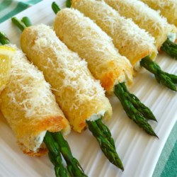 Asparagus Roll Ups Recipe - A savory bacon and chive filling makes these quick asparagus roll-ups extra-flavorful.