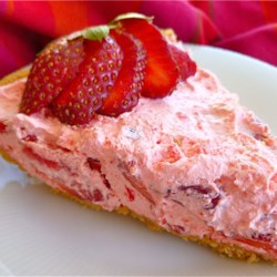 Fluffy Strawberry Pie Recipe - A fluffy, sweet filling with plenty of fresh strawberries in a graham cracker crust makes an easy no-bake pie.